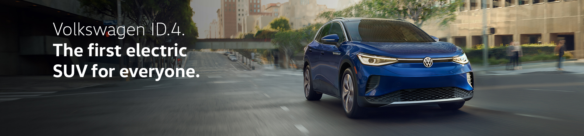 Blue-Volkswagen-ID4-electric-SUV-driving-down-the-street