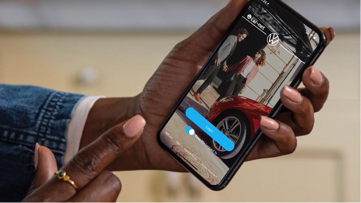 A person holding a smartphone about to tap the screen with their finger